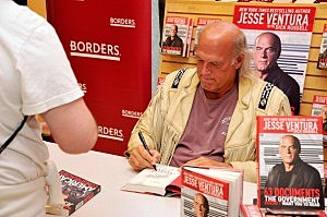 "Jesse Ventura Signs Copies Of ""63 Documents The Government Doesn't Want You To Read"""