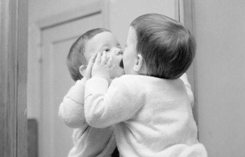 girl kissing self in mirror
