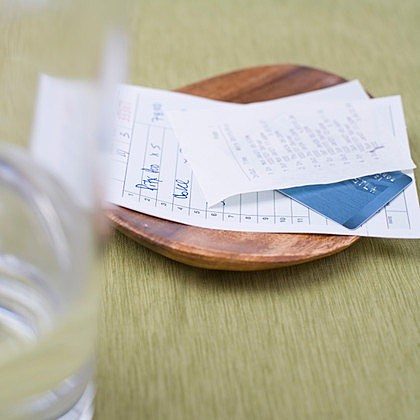 Credit Card and Restaurant Bill on Table